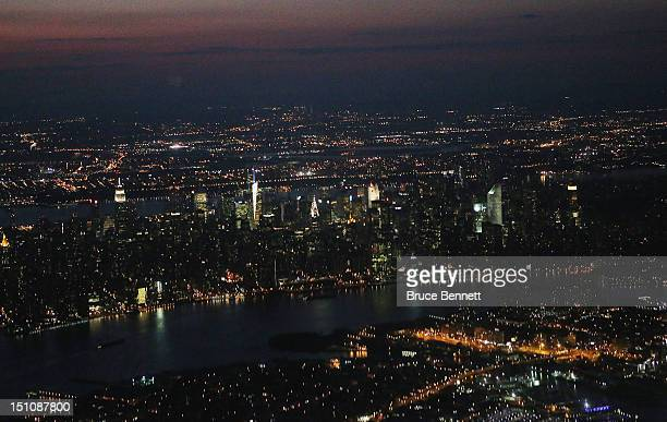 An aerial view of the Manhattan skyline at sunset as photographed from an airplane on August 28 2012 in New York New York