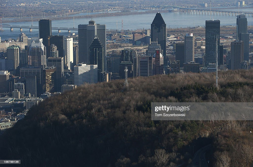 An aerial view of the Montreal skyline and The Cross in Mont Royal Park are seen from above on November 18, 2012 in Montreal, Quebec.