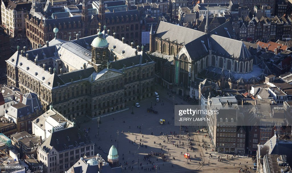 An aerial view of the New Church and the Royal Palace on the Dam in Amsterdam taken on March 5, 2013. The palace and the church will be the decor for the April 30, 2013 inauguration of King Willem-Alexander. AFP PHOTO / ANP - JERRY LAMPEN = netherlands out