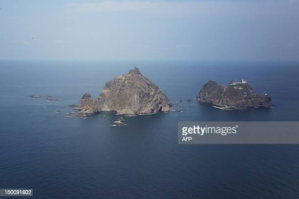An aerial view of the remote islands disputed with Japan known as Dokdo in Korea and Takeshima in Japan in the Sea of Japan on August 10 2012 South...