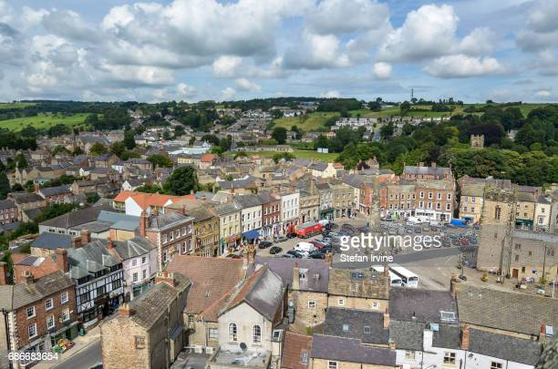 An aerial view of the shops houses and car park of the towncentre marketplace in Richmond North Yorkshire United Kingdom