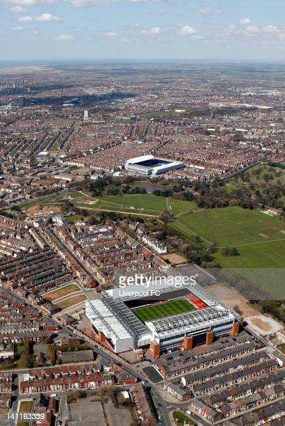 An aerial view of the Stadiums of Liverpool FC and Everton FC Anfield and Goodison Park seperated by Stanley Park and Anfield cemetery with the...