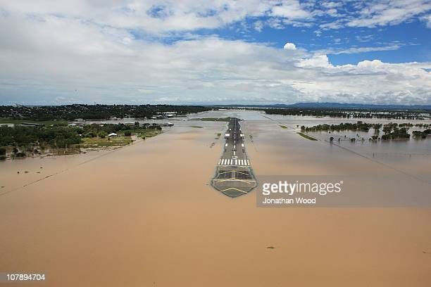 An aerial view of the submerged runway at Rockhampton airport on January 6 2011 in Rockhampton Australia Floodwaters peaked at 92 metres yesterday in...