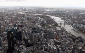 An aerial view of the Thames river in London from the air with The Gherkin in the foreground on September 5 2011 in London England