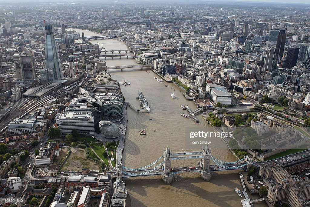An aerial view of the Thames river in London from the air with the Shard and Tower Bridge in the foreground on September 5, 2011 in London, England.