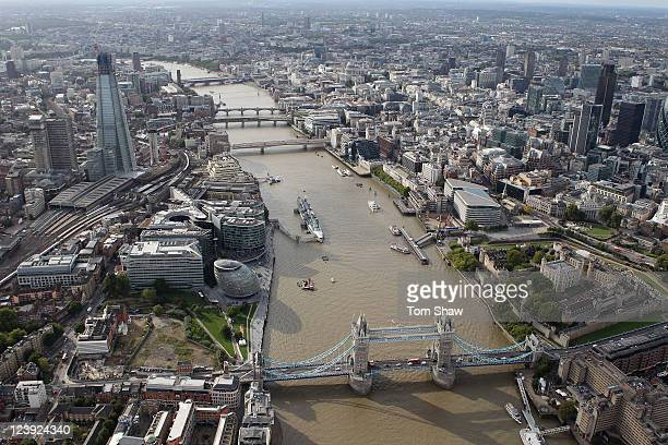 An aerial view of the Thames river in London from the air with the Shard and Tower Bridge in the foreground on September 5 2011 in London England