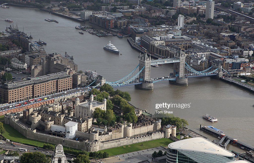 An aerial view of the Thames river in London from the air with Tower Bridge and the Tower Of London in the foreground on September 5, 2011 in London, England.