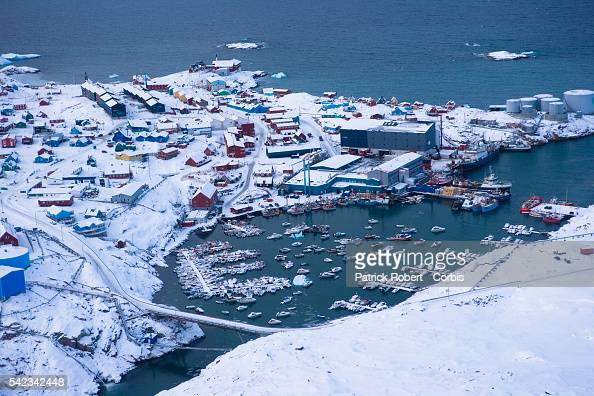 An aerial view of the town of Ilulissat in Greenland Though the disappearing ice cap could lead to higher sea levels all over the world Greenland's...