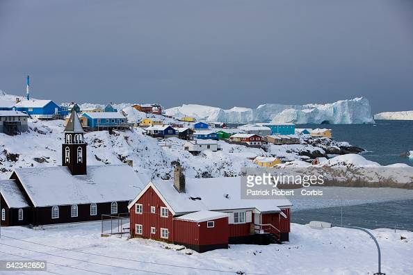 An aerial view of the town of Ilulissat in Greenland where the Sermeq Kujalleq glacier reaches into the sea in the backround Though the disappearing...