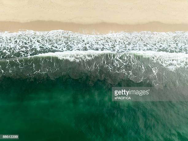 An aerial view of waves coming to shore.