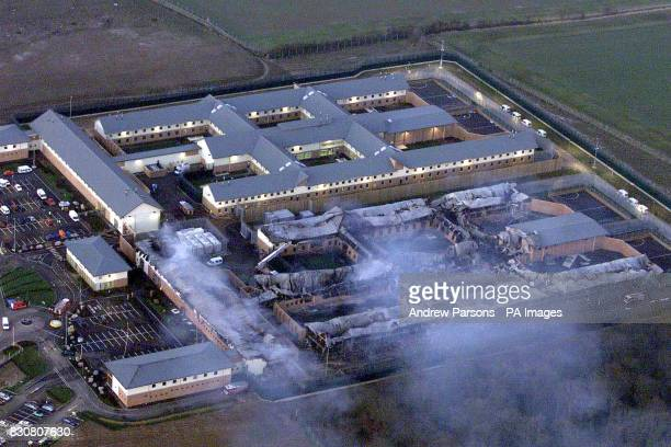 An aerial view of Yarl's Wood refugee camp in Bedfordshire still smouldering after a fire swept through the facility 01/04/02 has been temporarily...