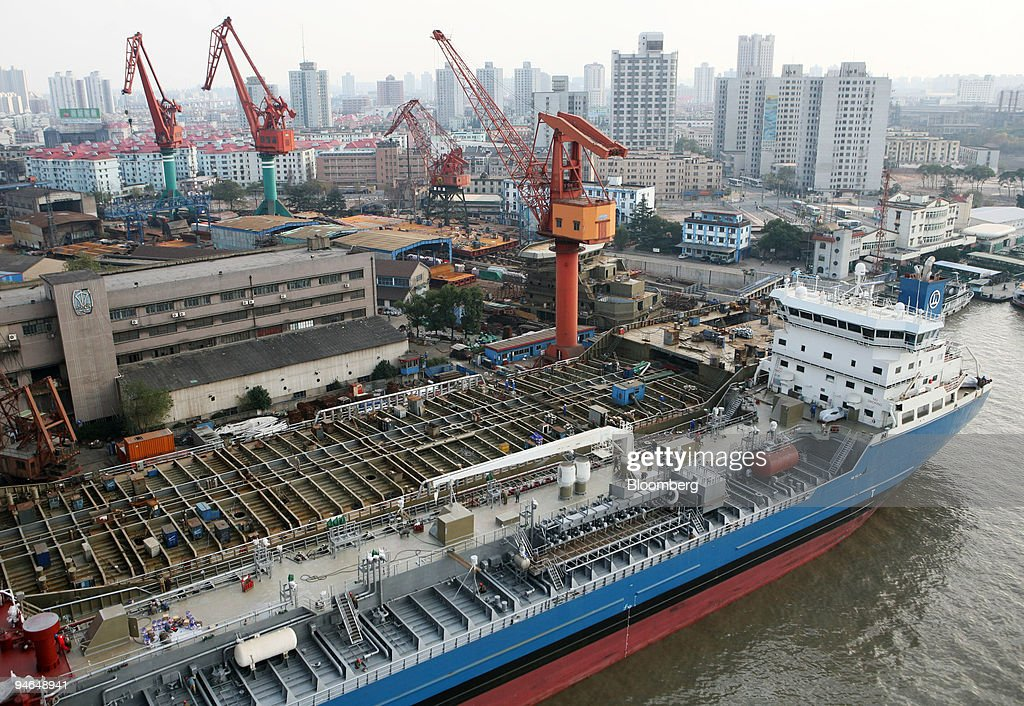 An aerial view showing ships being constructed at a shipyard on the Huangpu River in Shanghai China on Monday December 3 2006