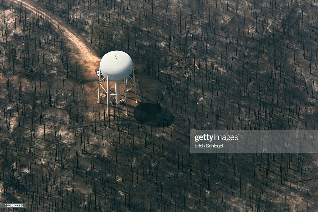 An aerial view shows a burned area around a water tower September 7, 2011 in Bastrop, Texas. Several large wildfires have been devastating Bastrop County for the last three days, but are now 30 percent contained, according to the Texas Forest Service.