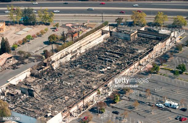 An aerial view shows a burned KMart retail store in Santa Rosa California on October 12 2017 Hundreds of people are still missing in massive...