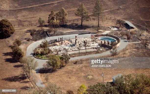 TOPSHOT An aerial view shows a burned property in Santa Rosa California on October 12 2017 Hundreds of people are still missing in massive wildfires...