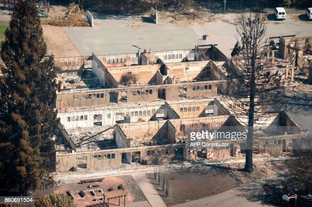 An aerial view shows a burned school in Santa Rosa California on October 12 2017 Hundreds of people are still missing in massive wildfires which have...
