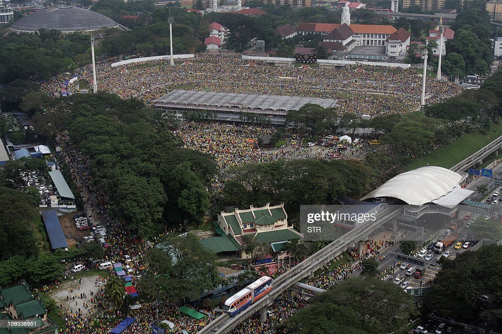An aerial view shows a crowd attending an opposition rally ahead of looming elections in Kuala Lumpur on January 12, 2013. Opposition organisers said this week a gathering at the 30,000-seater Stadium Merdeka (Independence Stadium) in the capital was to focus on continued widespread criticism of a voting system seen as skewed in favour of the ruling Barisan Nasional coalition. AFP PHOTO