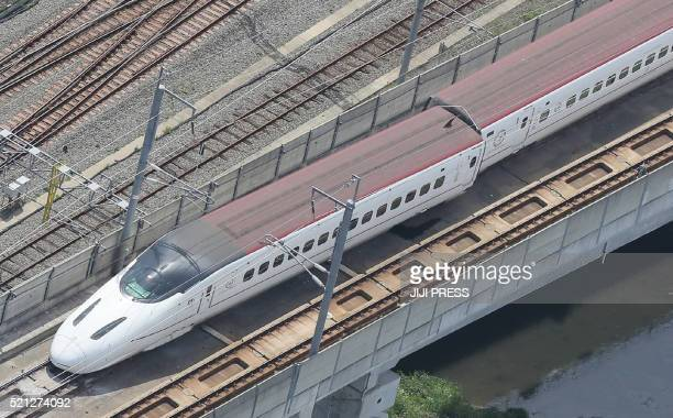 TOPSHOT An aerial view shows a derailed Kyushu shinkansen or bullet train in the city of Kumamoto Kumamoto prefecture on April 15 after a 64magnitude...