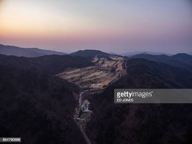 An aerial view shows a golf course used as the site of a recently installed anti Terminal High Altitude Area Defense system in Seongju on March 18...