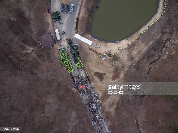 An aerial view shows a protest at the site of a recently installed anti Terminal High Altitude Area Defense system in Seongju on March 18 2017 South...