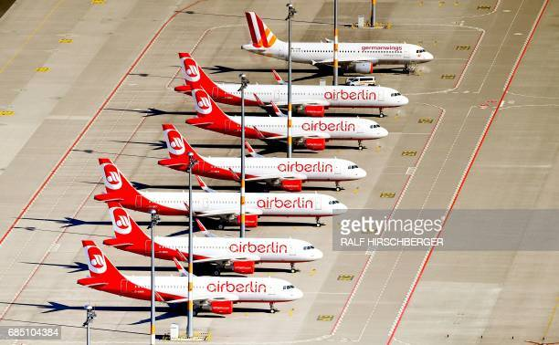 An aerial view shows airplanes operated by airline airberlin standing on the tarmac near the unfinished BER Willy Brandt Berlin Brandenburg...