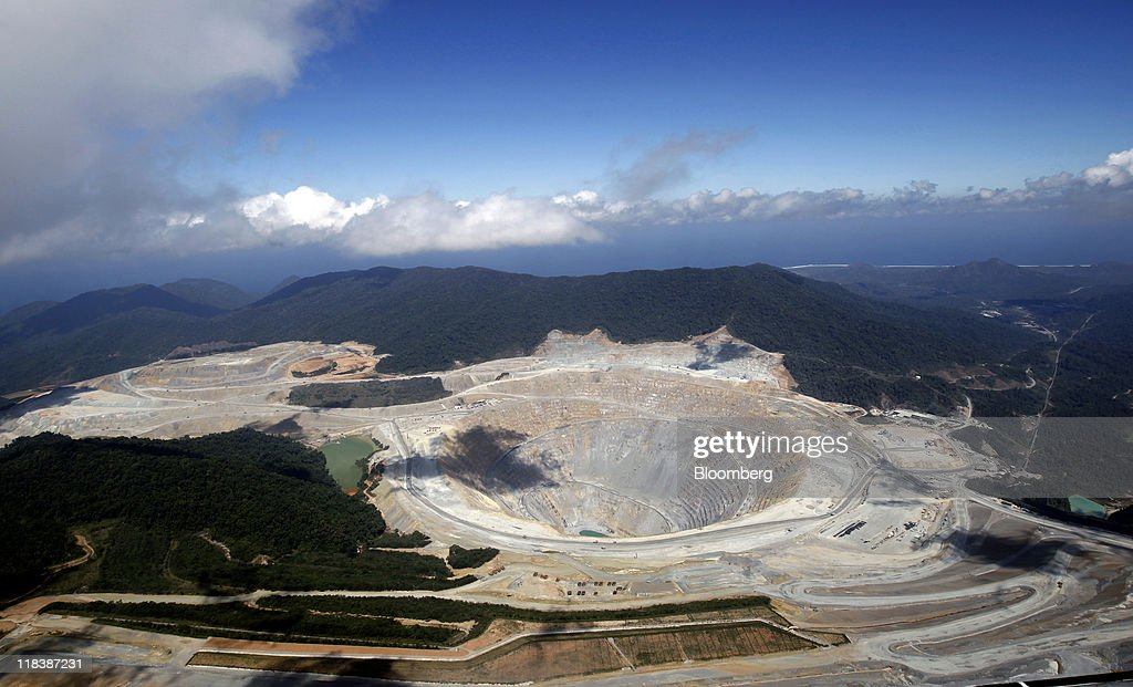 An aerial view shows an open pit at the Batu Hijau copper and gold mine operated by PT Newmont Nusa Tenggara in Sumbawa, West Nusa Tenggara province, Indonesia, on Thursday, June 30, 2011. PT Newmont Nusa Tenggara is a unit of Newmont Mining Corp. Photographer: Dadang Tri/Bloomberg via Getty Images