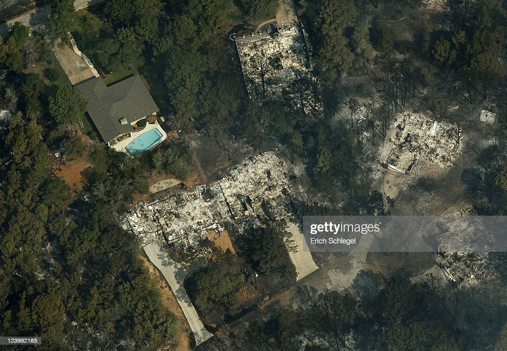 An aerial view shows burned houses in the Tahitian Village subdivision September 7, 2011 in Bastrop, Texas. Several large wildfires have been devastating Bastrop County for the last three days, but are now 30 percent contained, according to the Texas Forest Service.