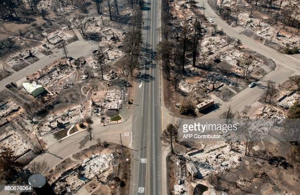An aerial view shows burned properties in Santa Rosa California on October 12 2017 Hundreds of people are still missing in massive wildfires which...