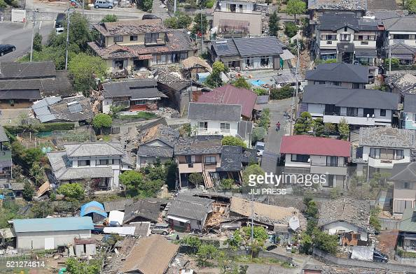 TOPSHOT An aerial view shows damaged houses in the town of Mashiki in Kumamoto prefecture on April 15 after a strong 64magnitude earthquake hit...