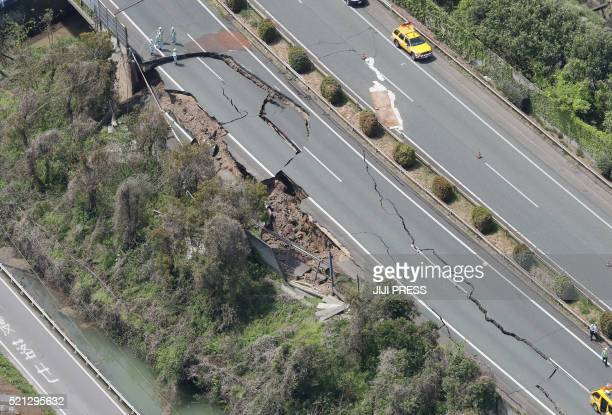 TOPSHOT An aerial view shows damaged Kyushu highway in the city of Mashiki Kumamoto prefecture on April 15 after a strong 64magnitude earthquake hit...