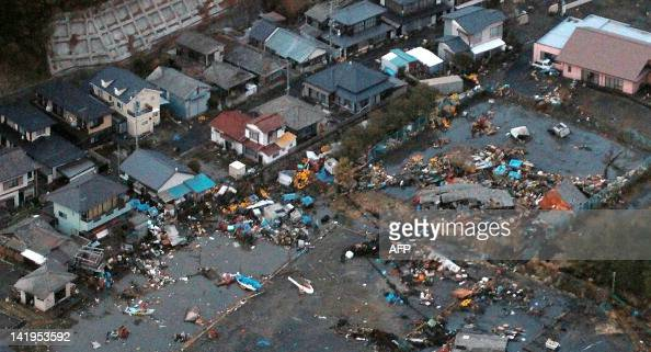 An aerial view shows debris that remained on the ground after a tsunami wave to have hit Hitachinaka city in Ibaraki prefecture on March 11 2011 A...