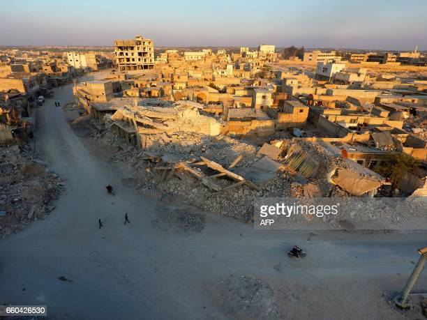 TOPSHOT An aerial view shows destruction in alBab on March 29 2017 a month after Turkishbacked rebels recaptured the northern Syrian town from...