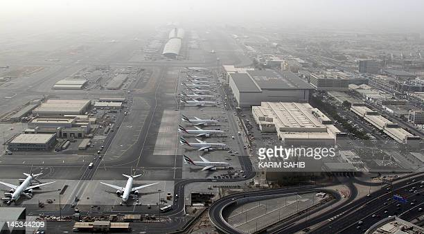 An aerial view shows Dubai international airport home to the national carrier Emirates Airways on May 27 2012 AFP PHOTO/KARIM SAHIB