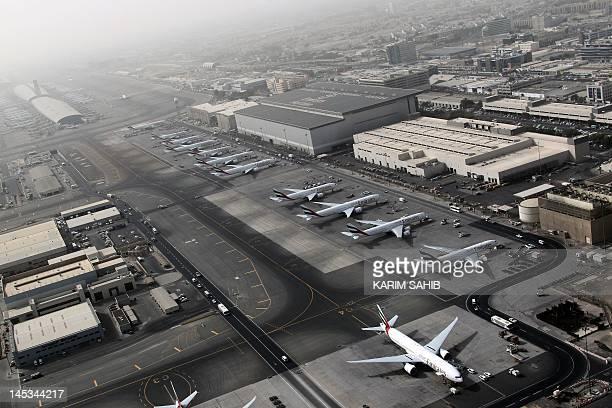 An aerial view shows Dubai international airport home to the national carrier Emirates Airways on May 27 2012 AFP PHOTO/KARIM SAHIB / AFP / KARIM...
