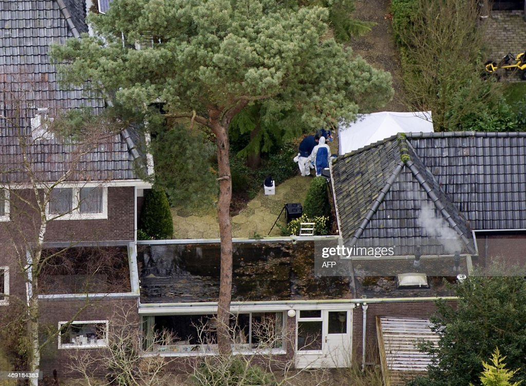 An aerial view shows Dutch police investigating in the residence of late former Dutch health minister Els Borst, in Bilthoven on February 13, 2014. Borst, who helped introduce the world's first euthanasia law in 2002 and who was found dead in her garage on February 10, 2014, was 'likely killed', police said.