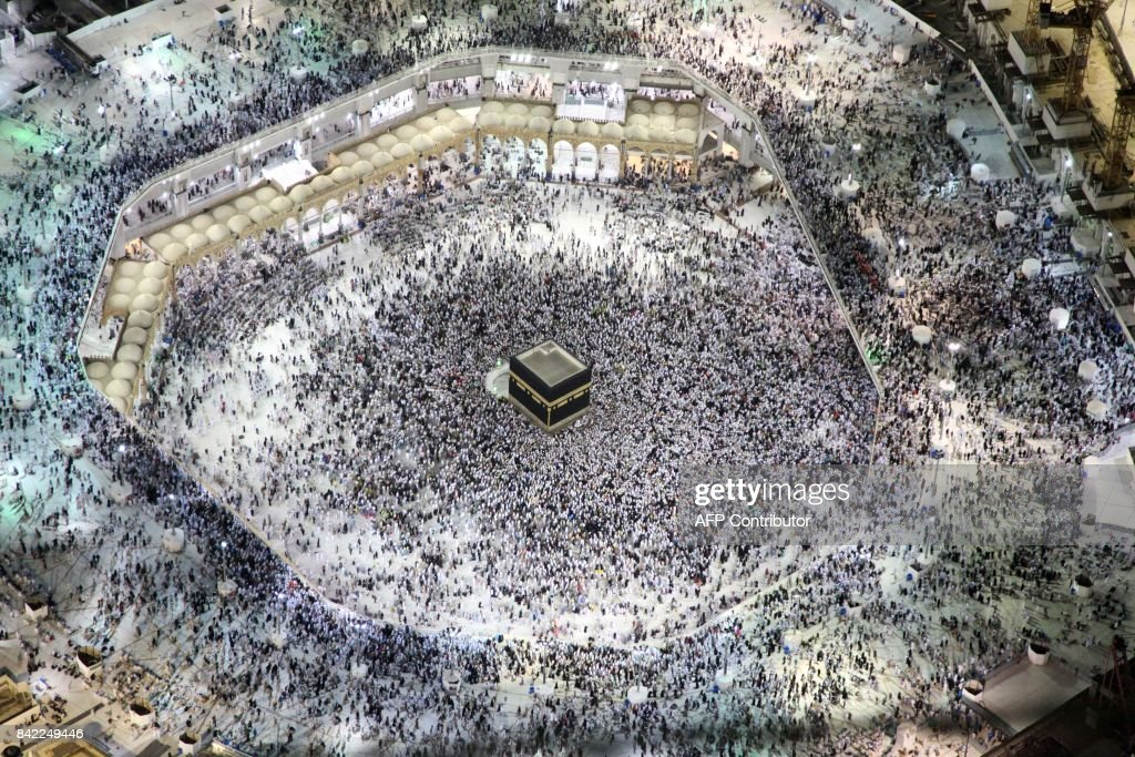 TOPSHOT - An aerial view shows Muslim pilgrims circumambulating the Kaaba, Islam's holiest shrine, at the Grand Mosque in Saudi Arabia's holy city of Mecca on September 3, 2017, during the annual Hajj pilgrimage. /