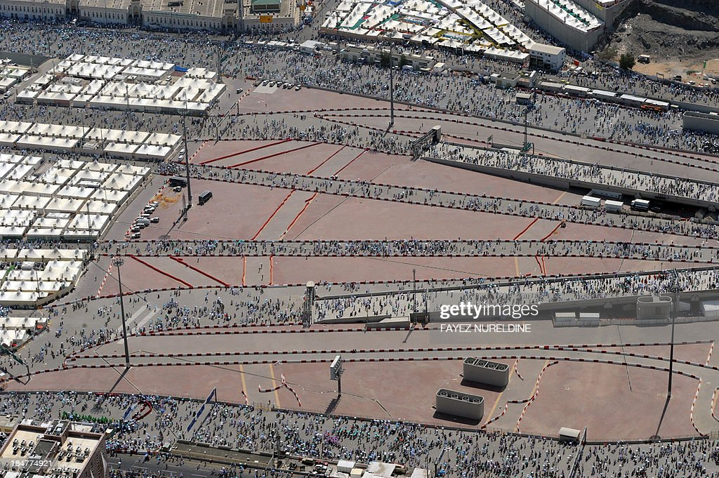 An aerial view shows Muslim pilgrims walk on way for throwing pebbles at pillars during the 2nd day of 'Jamarat' ritual, the stoning of Satan, in Mina near the holy city of Mecca, on October 16, 2013. Pilgrims pelt pillars symbolising the devil with pebbles to show their defiance on the third day of the hajj as Muslims worldwide mark the Eid al-Adha or the Feast of the Sacrifice, marking the end of the hajj pilgrimage to Mecca and commemorating Abraham's willingness to sacrifice his son Ismail on God's command in the holy City of Mecca.