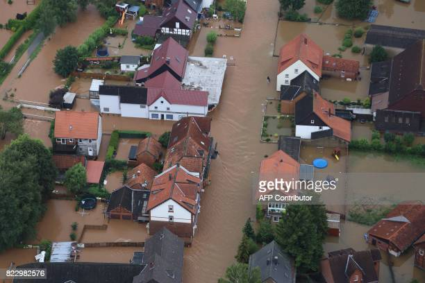 An aerial view shows overflooded streets in Rhueden northern Germany on July 26 2017 Some parts of lower saxony are overflooded after heavy rainfall...