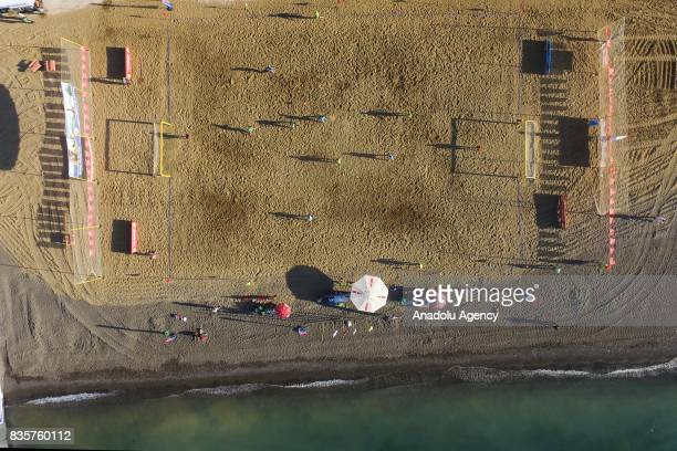 An aerial view shows people playing beach soccer on an artificial beach next to the Van Lake as people swim on a summer day in Gevas District of...