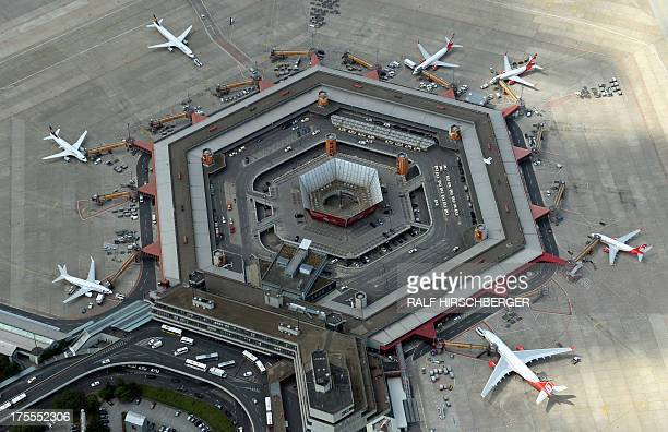 An aerial view shows planes of German airline companies Lufthansa and Air Berlin parked at Tegel Airport in Berlin Germany on August 1 2013 AFP PHOTO...