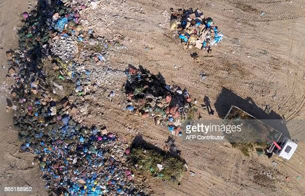 An aerial view shows rubbish at the Kotsiatis landfill on the outskirts of the Cypriot capital Nicosia on August 28 2017 With more visitors heading...