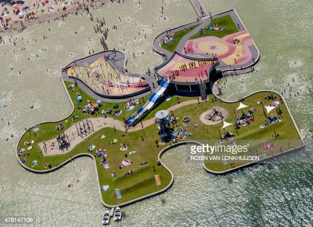 An aerial view shows sunbathers at the Maarsseveense Plassenaround recreational park in Utrecht the Netherlands on July 1 on a warm summer day A...
