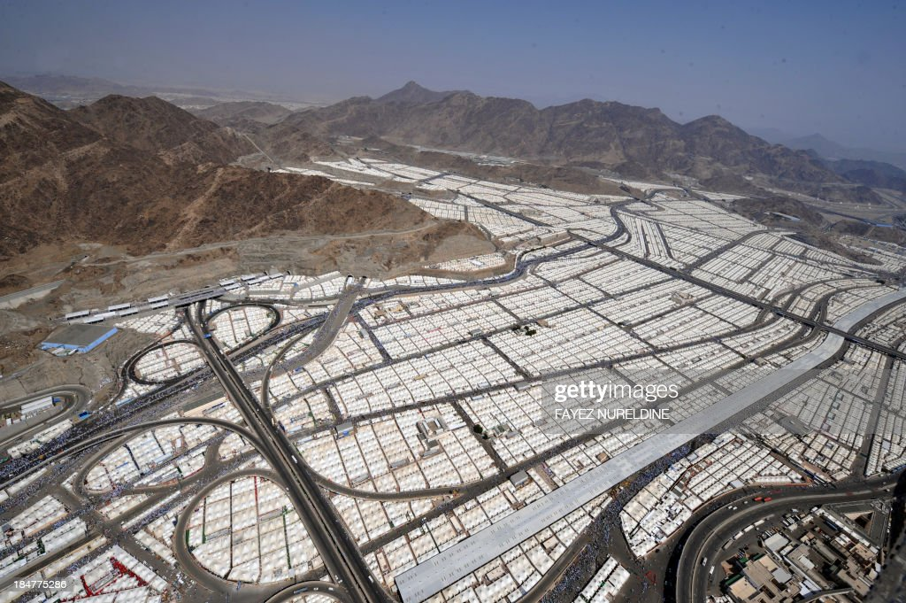 An aerial view shows tens of thousands of tents hosting piligrms in Mina near the holy city of Mecca, on October 16, 2013. Pilgrims pelt pillars symbolising the devil with pebbles to show their defiance on the third day of the hajj as Muslims worldwide mark the Eid al-Adha or the Feast of the Sacrifice, marking the end of the hajj pilgrimage to Mecca and commemorating Abraham's willingness to sacrifice his son Ismail on God's command in the holy City of Mecca. AFP PHOTO/FAYEZ NURELDINE