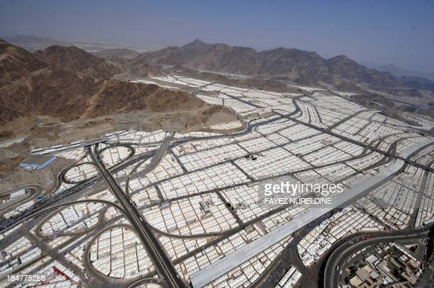 An aerial view shows tens of thousands of tents hosting piligrms in Mina near the holy city of Mecca on October 16 2013 Pilgrims pelt pillars...