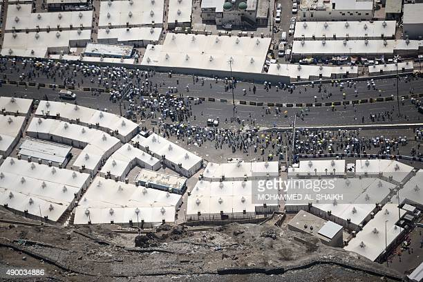 An aerial view shows tents hosting pilgrims in Mina near the holy city of Mecca on September 25 2015 At least 700 people were killed and hundreds...