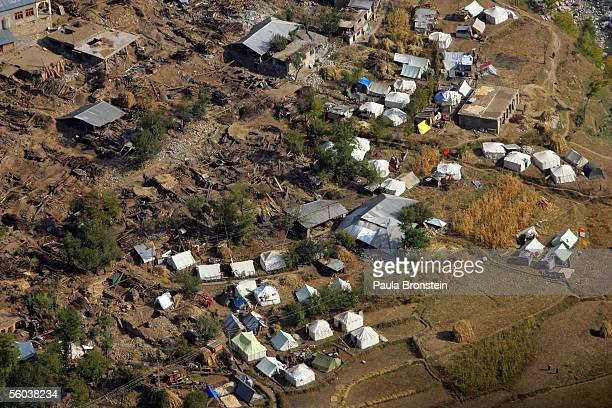 An aerial view shows tents lined up near destruction from this month's earthquake October 312005 near Gantar Alai Valley in Pakistan The death toll...