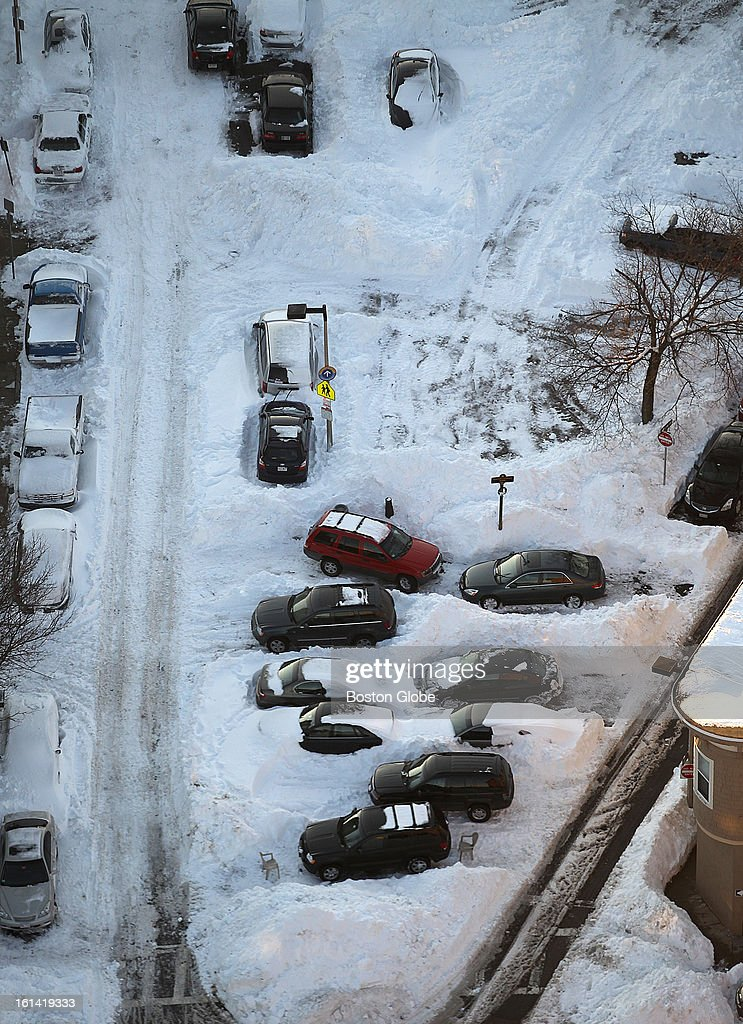 An aerial view shows that cars are still packed in by show on M Street in South Boston as dusk approaches on Sunday, Feb. 10, 2013, after a blizzard hit New England.