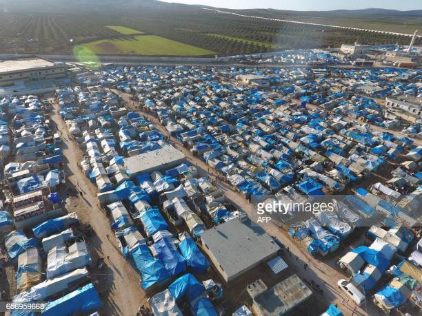 An aerial view shows the Bab alSalama camp set up outside the Syrian city of Azaz on Syria's northern border with Turkey on March 23 2017 / AFP PHOTO...