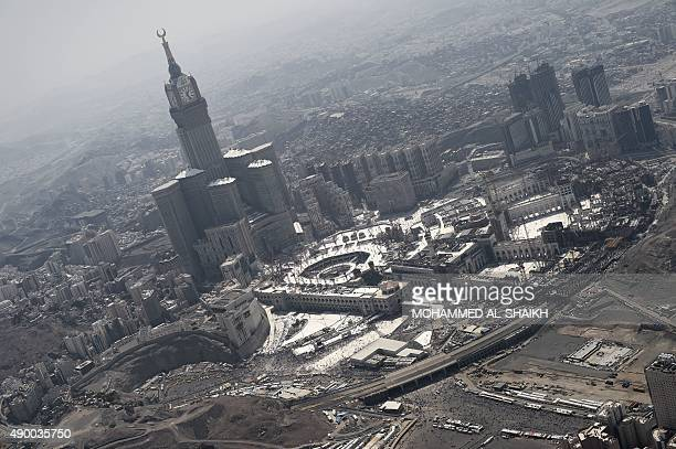 An aerial view shows the Clock Tower and the Grand Mosque in Saudi Arabia's holy Muslim city of Mecca on September 25 2015 At least 700 people were...