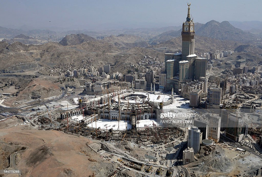 An aerial view shows the Clock Tower and the Grand Mosque in the holy city of Mecca, on October 16, 2013. Saudi Arabia said that around 1.98 million pilgrims are performing this year's annual Muslim pilgrimage, the hajj, sharply fewer than last year due to reduced quotas.